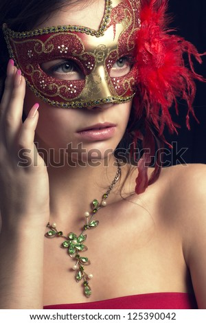 beautiful young woman in a  mysterious venetian mask
