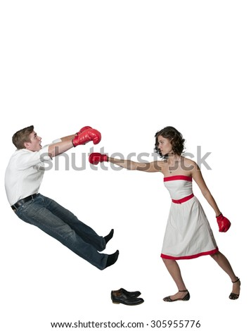 Beautiful young woman in a red and white dress wearing a pair of boxing gloves