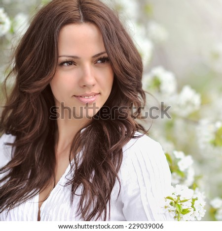 Beautiful young woman in a summer park outdoor portrait close up - stock photo