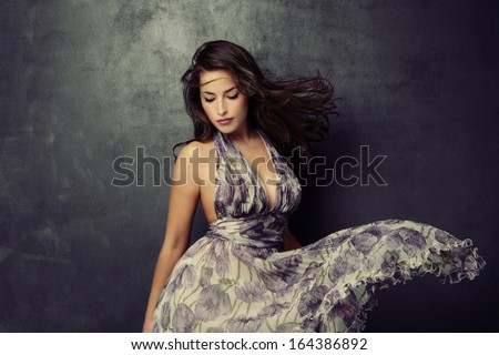 beautiful young  woman in an elegant dress studio shot - stock photo