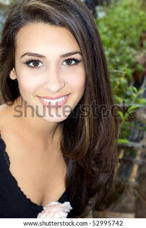 Beautiful Young Woman in an outdoor lifestyle scene. - stock photo