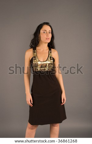 beautiful young woman in attractive dress - stock photo