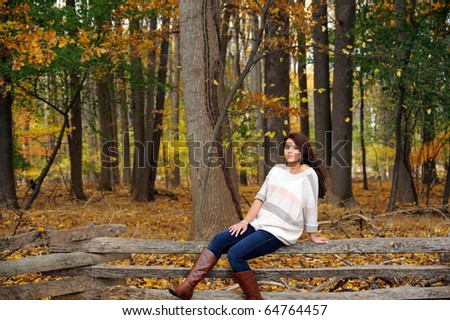 Beautiful young woman in autumn forest