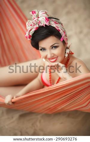 Beautiful young woman in bikini at beach, retro girl pinup style, happy female in swimsuit outdoor portrait, sensual brunette female in elegant swimwear resting at Miami beach, soft focus, series - stock photo