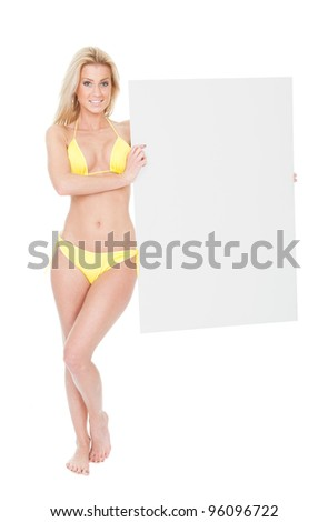 Beautiful young woman in bikini presenting empty board. Isolated on white - stock photo