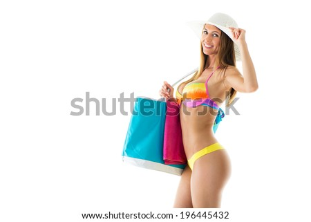 Beautiful young woman in bikini with Sun Hat and holding beach bag. Isolated on white background - stock photo