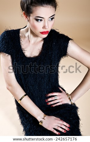 Beautiful young woman in black dress. Fashion photo - stock photo