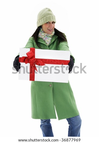 beautiful young woman in coat and hat holding present, clipping path