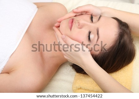 Beautiful young woman in cosmetic salon close up - stock photo