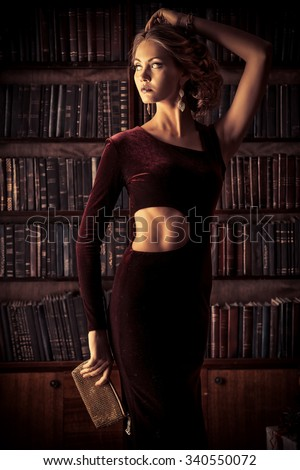 Beautiful young woman in  evening dress posing in vintage interior. Jewellery.  Fashion shot. - stock photo