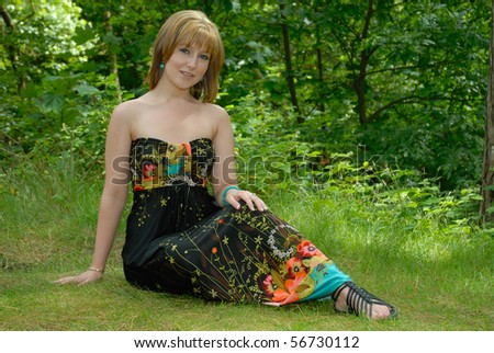 Beautiful young woman in forest clearing