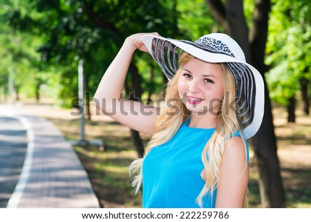 beautiful young woman in hat park