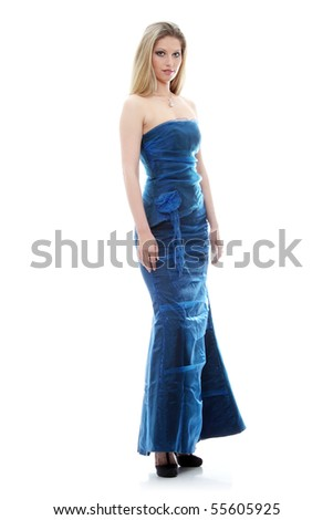 Beautiful young woman in long blue dress, full portrait - stock photo