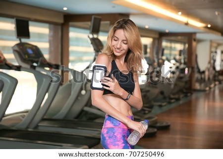 Beautiful young woman in modern gym