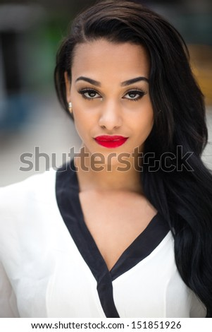 Beautiful young woman in New York City portrait face close up smiling - stock photo