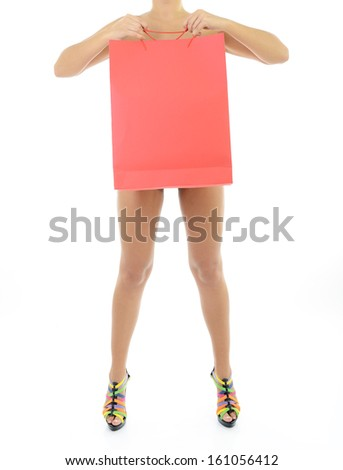 Beautiful young woman in panties only holding shopping bag, full length portrait over white background - stock photo