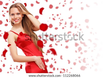 Beautiful young woman in red dress and flowers