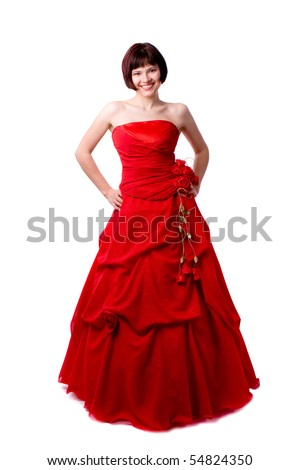 Beautiful young woman in red long dress. Girl in red dress portrait.  Happy woman in red prom dress. - stock photo