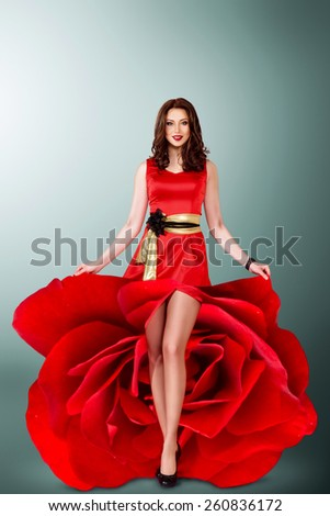 Beautiful young woman in red rose flower dress. full length studio portrait - stock photo