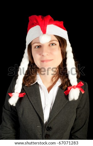 Beautiful young woman in red wearing santa hat - stock photo