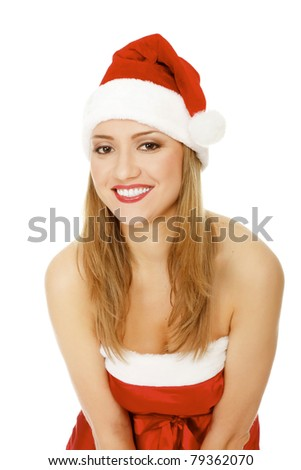 Beautiful young woman in red wearing santa hat. Isolated on white background. - stock photo