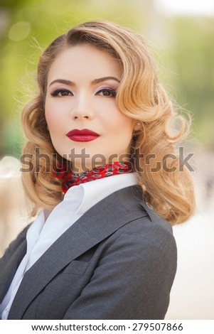 Beautiful young woman in retro style walking in the city. Summer photo