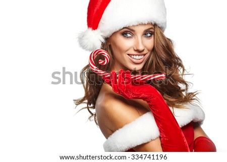 Beautiful young woman in Santa Claus clothes over white background. - stock photo