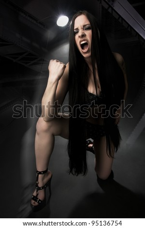 Beautiful young woman in sexy lingerie screaming - stock photo