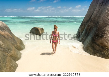 Beautiful young woman in Seychelles tropical beach. - stock photo