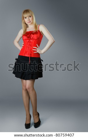 Beautiful young woman in short skirt posing - stock photo