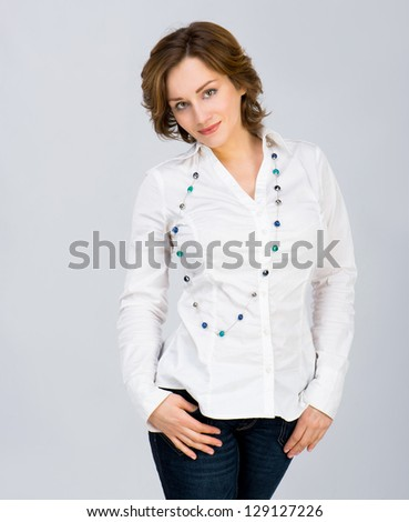 beautiful young woman in studio - stock photo