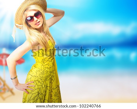 Beautiful young woman in summer dress - stock photo