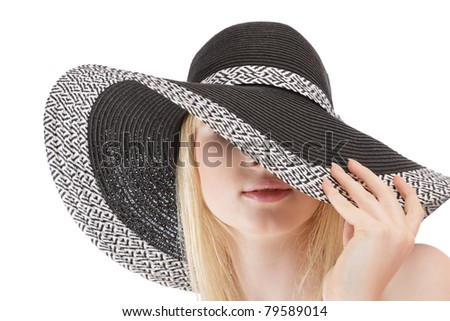 Beautiful young woman in sun hat studio shot isolated over white - stock photo