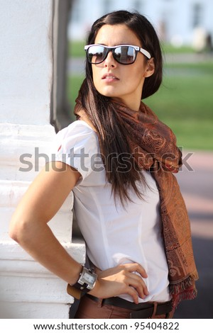 Beautiful young woman in sunglasses. Outdoor portrait - stock photo