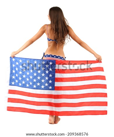 Beautiful young woman in swimsuit with with American flag isolated on white - stock photo