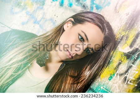 Beautiful young woman in the sreet - stock photo