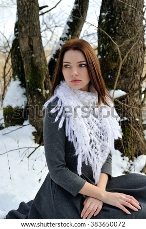 Beautiful young woman in the winter forest - stock photo