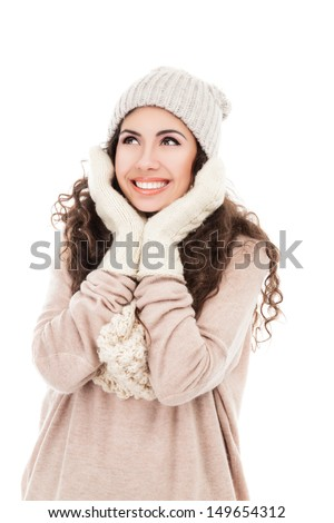 Beautiful young woman in warm clothing isolated on white background - stock photo