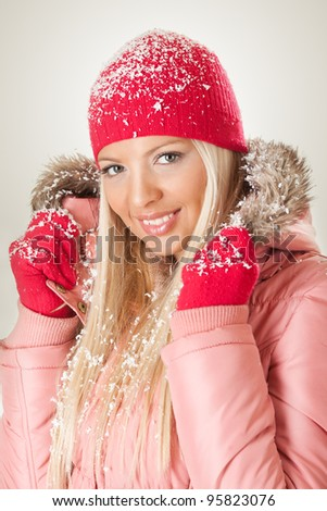 Beautiful young woman in warm clothing posing and Looking At Camera