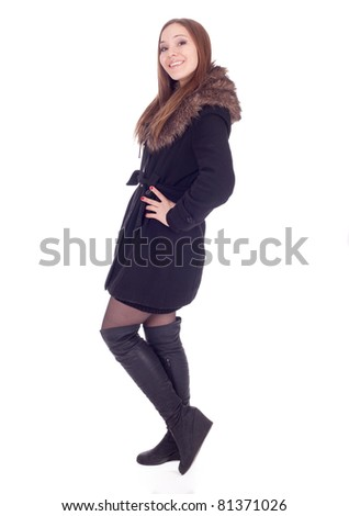 beautiful young woman in winter jacket with fur