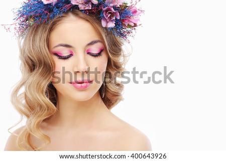 Beautiful young woman in wreath - stock photo