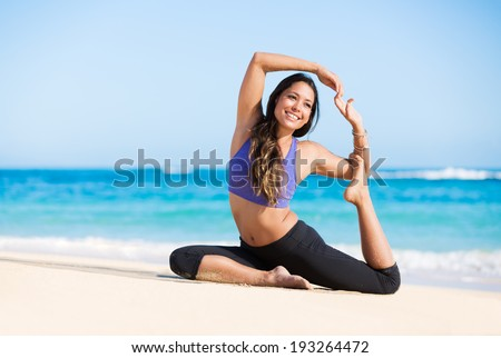 Beautiful young woman in yoga pose at the beach. Morning zen mediation outdoors. Practicing yoga. Healthy Active Lifestyle Concept. - stock photo