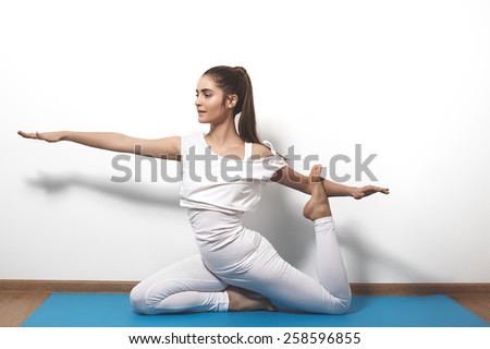 Beautiful Young Woman In Yoga Posing On A Studio Background Nice Sport Hairstyle Like Pony