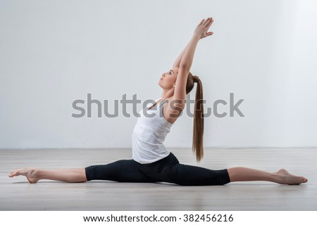 Beautiful young woman is doing the exercise - stock photo