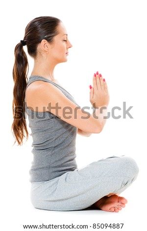 beautiful young woman is meditation. isolated on white background - stock photo
