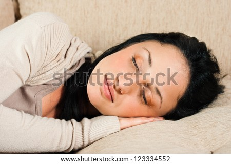 Beautiful young woman is sleeping on the sofa,Time for a nap - stock photo