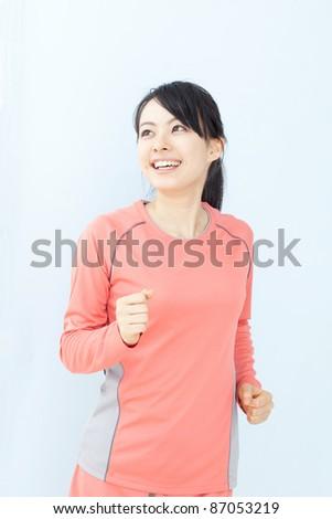 beautiful young woman jogging - stock photo