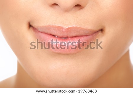 Beautiful young woman lips. Close up over  white background - stock photo