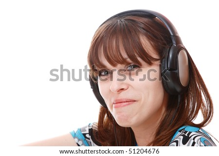 Beautiful young woman Listening to Music - stock photo