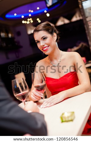 Beautiful young woman looking at her boyfriend with love - stock photo